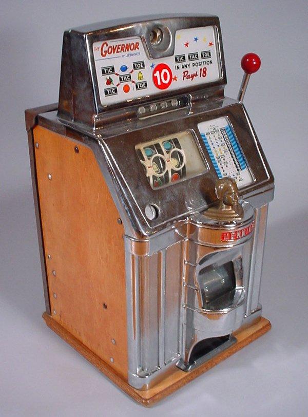 "4023: ""Jennings"" Vintage Slot Machine with brass Native"