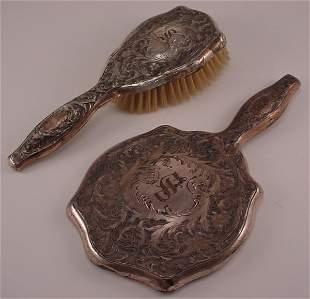 2pc Sterling dresser set. Hand mirror and brush,