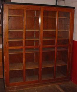 Oak double door bookcase. Made ca. 1910. Features