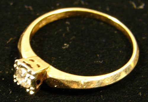 21: Diamond Solitaire set in 14k Yellow Gold Band. Ladi