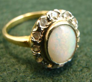 1002: Cabochon Opal Ring with lots of Fire! Surrounded