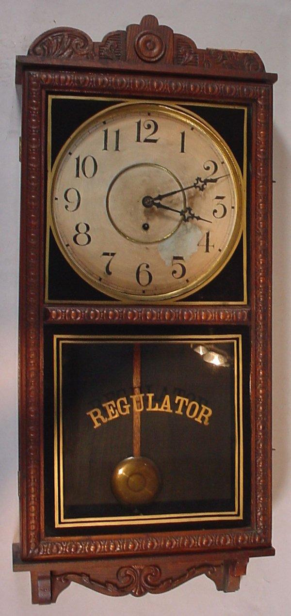 """1336: """"Waterbury Clock Co"""" Hanging Oak Regulator Clock."""
