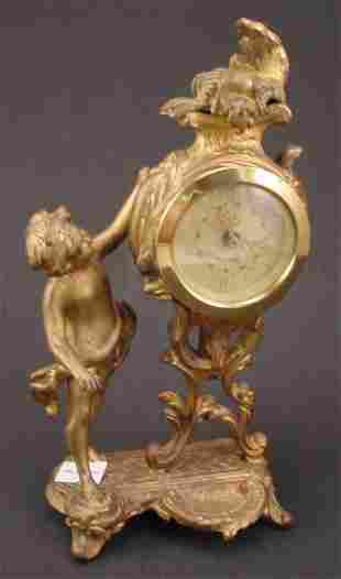 Antique Figural gilded Metal with cherub. Movement