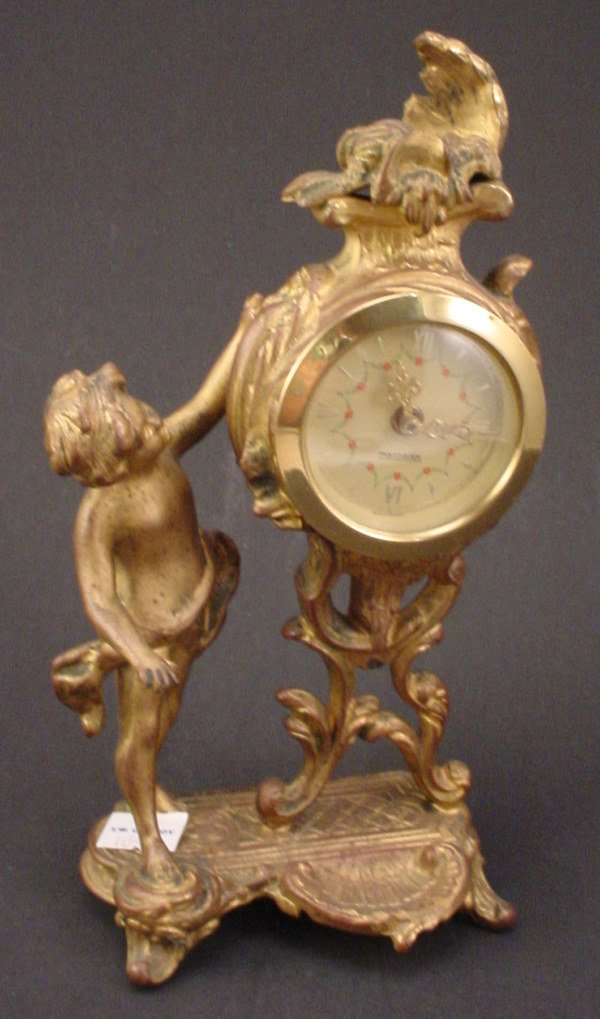 21: Antique Figural gilded Metal with cherub. Movement