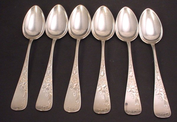 7: Sterling silver set of six teaspoons with monograms.