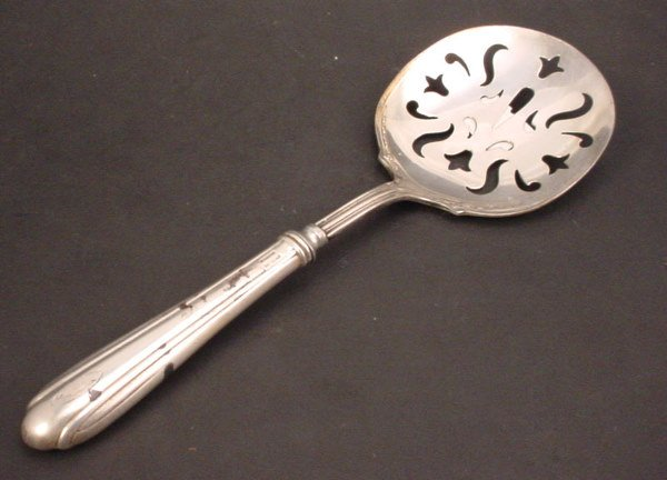 9: Sterling handled tomato server with pierced silver p