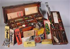 2062: Antique wood fishing tackle box loaded with fishi