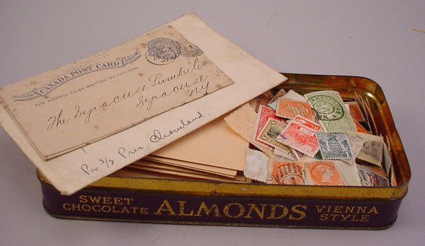 1: Lot of foreign stamps in tin.