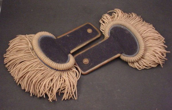 1043: Civil War era Epaulets covered in dark blue felt