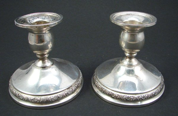 """2015: Pair Sterling weighted low candleholders. """"Prelud"""