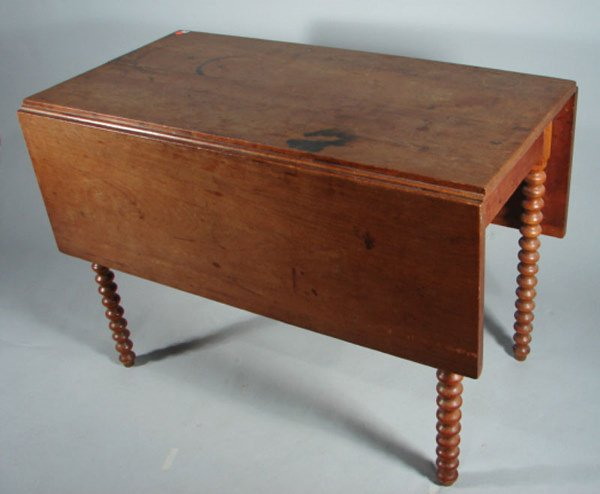 5: Early Drop leaf table with exaggerated spool legs. S