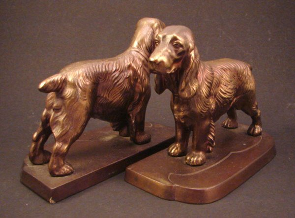 8: Patinated white metal figural bookends.