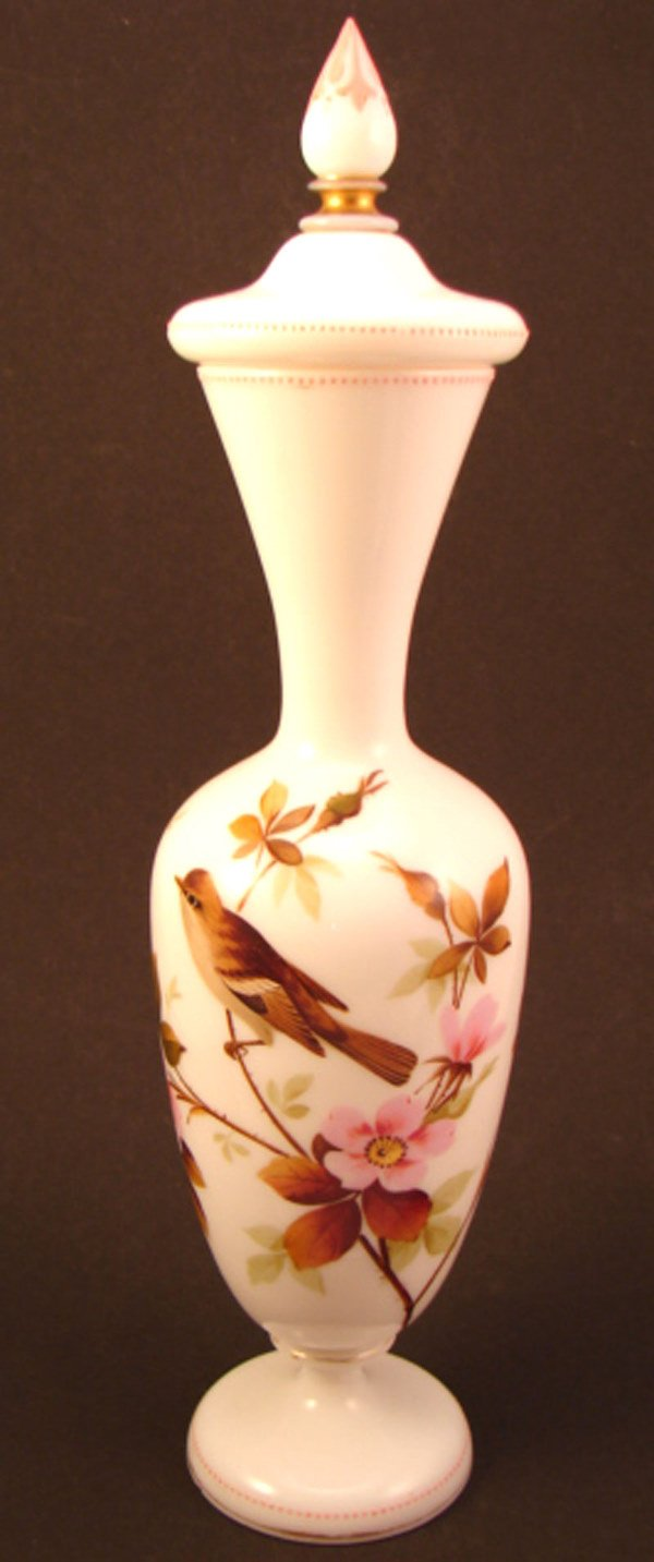 14: Hand painted milk glass vase with stopper. Featurin