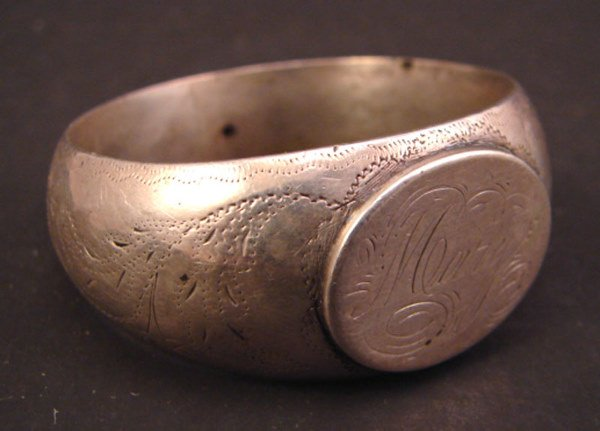 "1005: Coin ? Ring Form Napkin Ring. Marked ""Mary"". 1850"