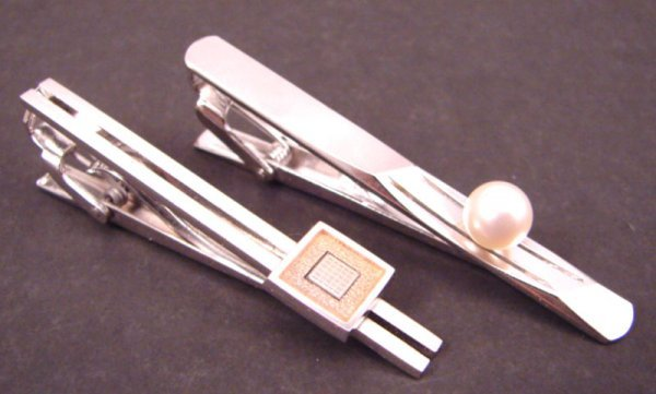 """7: Two Tie Clips. One marked """"Fujitsu"""" and the other """"S"""
