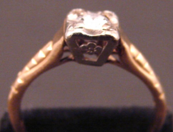 17: 14k Diamond Ring.