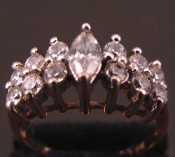19: Diamond Ring, 10k with seven diamonds.