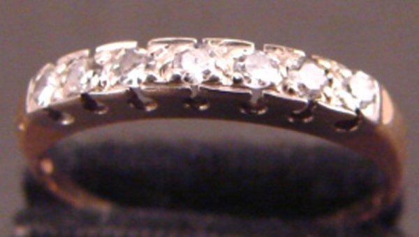 22: 14k Diamond Ring.