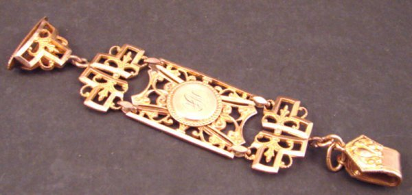 23: Gold Watch Fob.