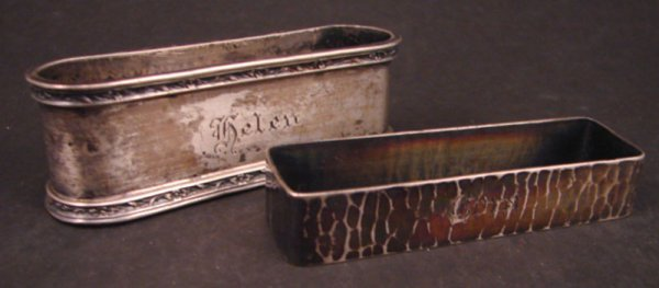 2006: Two Sterling Silver Napkin Rings including hand w