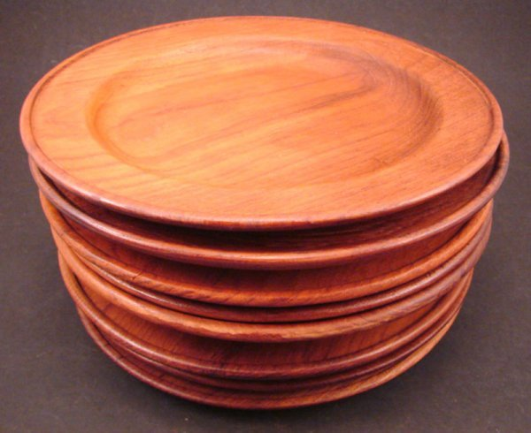 """1001: Eight Teak Plates. Marked """"Made in Thailand Galax"""