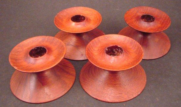 "1006: Four Vintage Teak Low Candle Holders. Marked ""Tea"