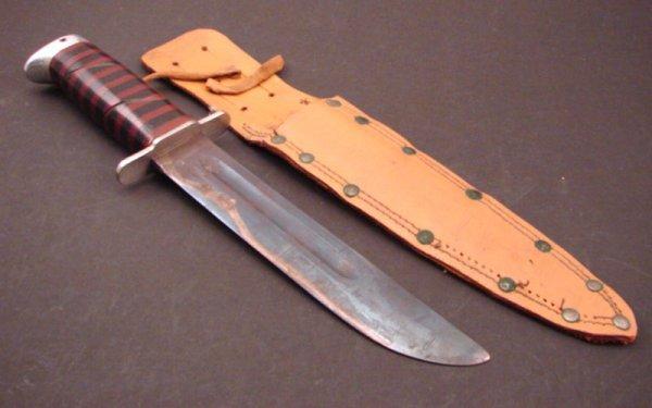 """3002: Knife with sheath. Knife 11 3/4"""" l."""
