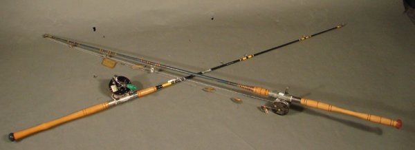 """3013A: Two Fishing Poles with reels. Label reads """"Sheld"""