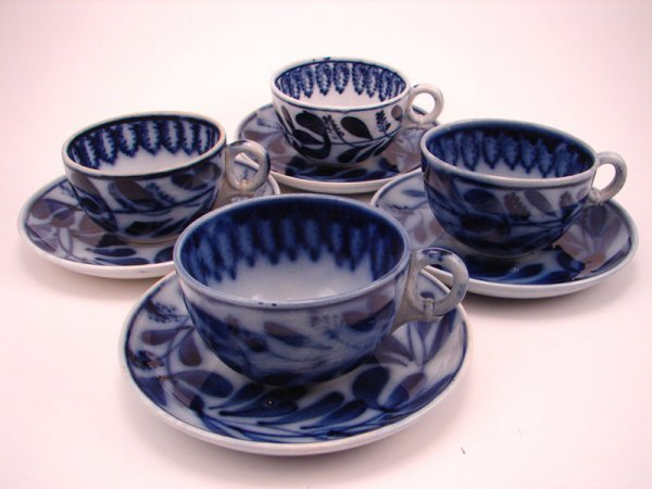 2001A: Four Flow Blue Spinach pattern Tea cup and sauce