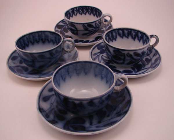 2002: Four Flow Blue Spinach pattern Tea cup and saucer