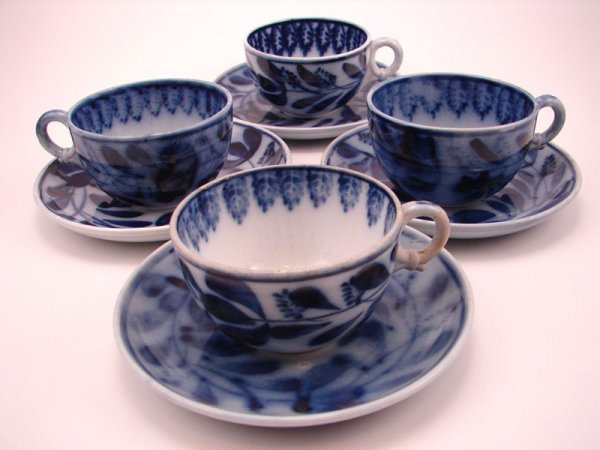 2003A: Four Flow Blue Spinach pattern Tea cup and sauce
