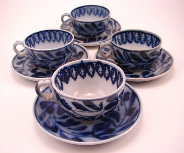 2004: Four Flow Blue Spinach pattern Tea cup and saucer
