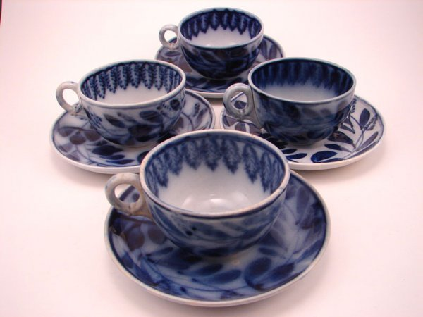 2004A: Four Flow Blue Spinach pattern Tea cup and sauce