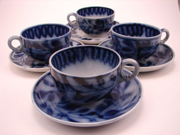 2005A: Four Flow Blue Spinach pattern Tea cup and sauce