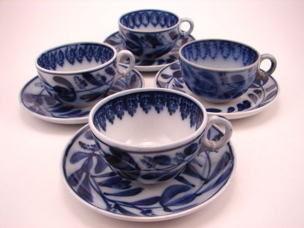 2006A: Four Flow Blue Spinach pattern Tea cup and sauce