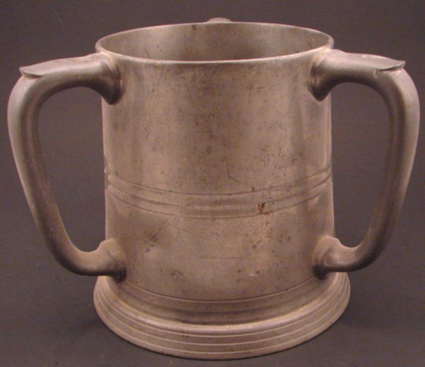 2356: Large Three Handle Pewter Tankard with glass bott