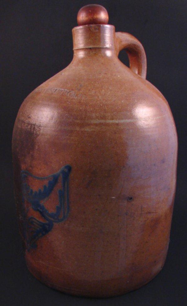 7002: Whites Utica NY 2 Gallon Stoneware Jug with blue