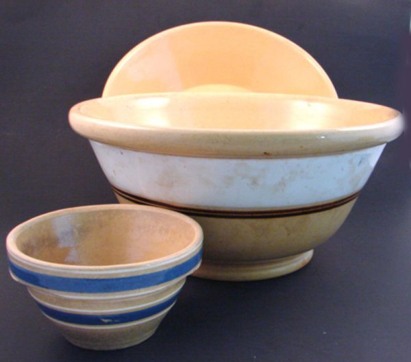 7007: Three pieces Yellowware Stoneware Bowls. Mixing b