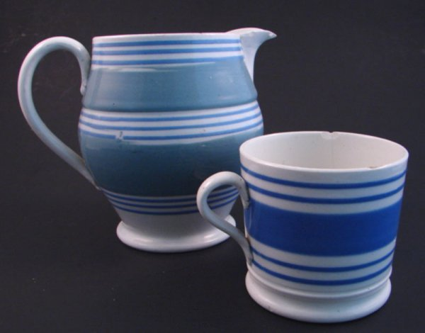 7010: Two pieces Mocha ware including pitcher and mug.