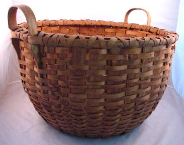 7016: Antique Splint Basket with two handles. Minor spl
