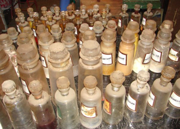 7242: Antique Apothecary Bottles. Varying sizes and con