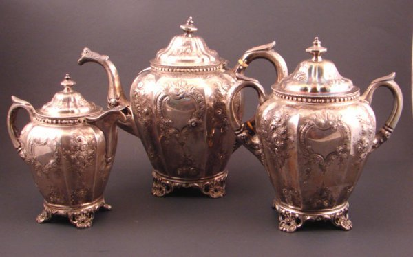 7: Circa 1855 3pc Silver tea set with floral design and