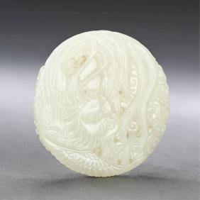 A CHINESE WHITE JADE PHOENIX AND DRAGON PENDANT