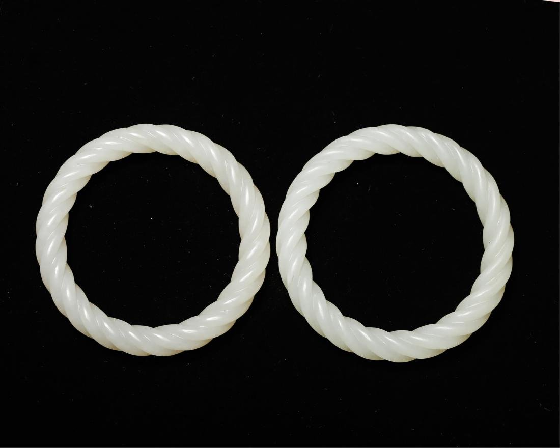 PAIR OF CHINESE WHITE JADE TWISTED BANGLE