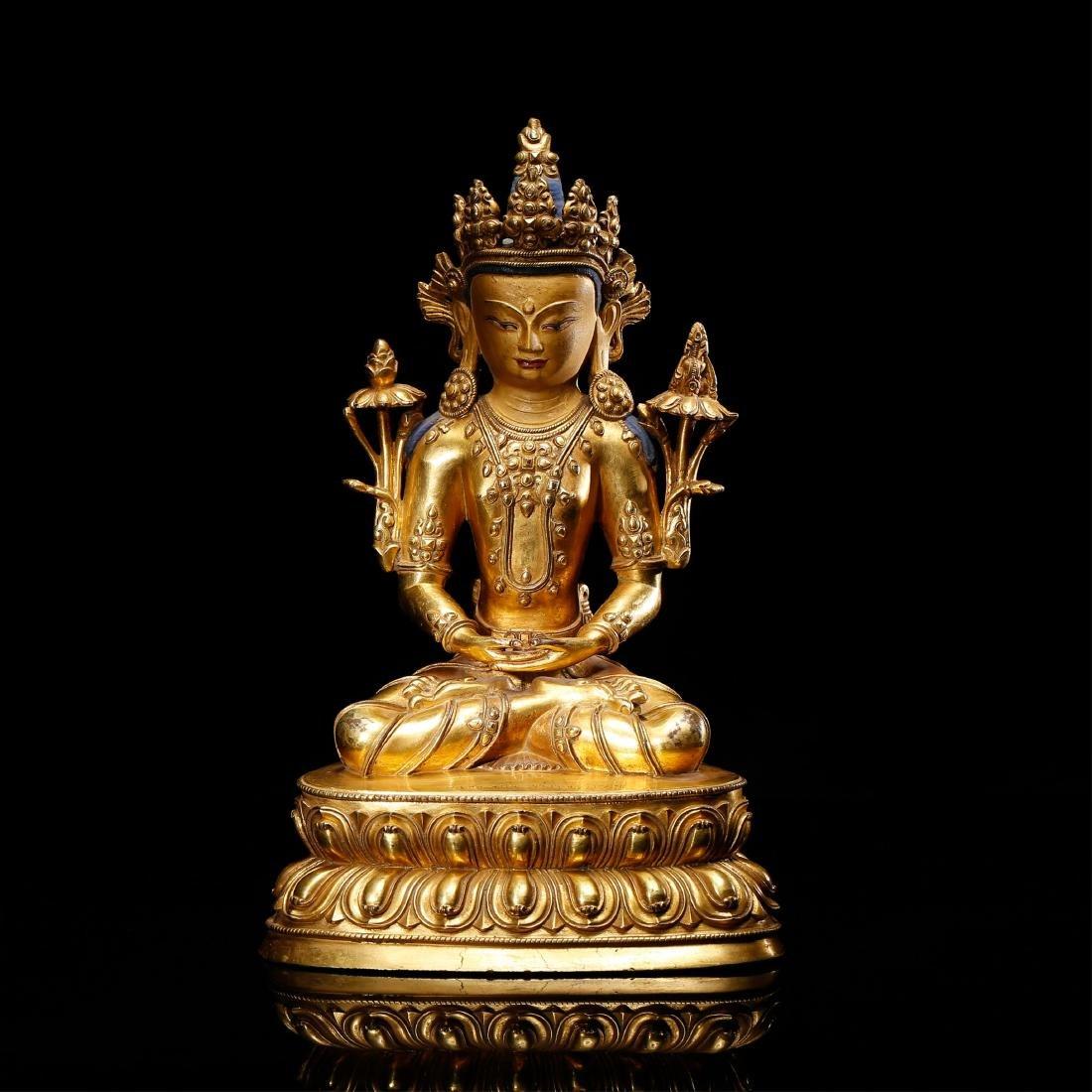 CHINESE GILT BRONZE FIGURE OF BUDDHA