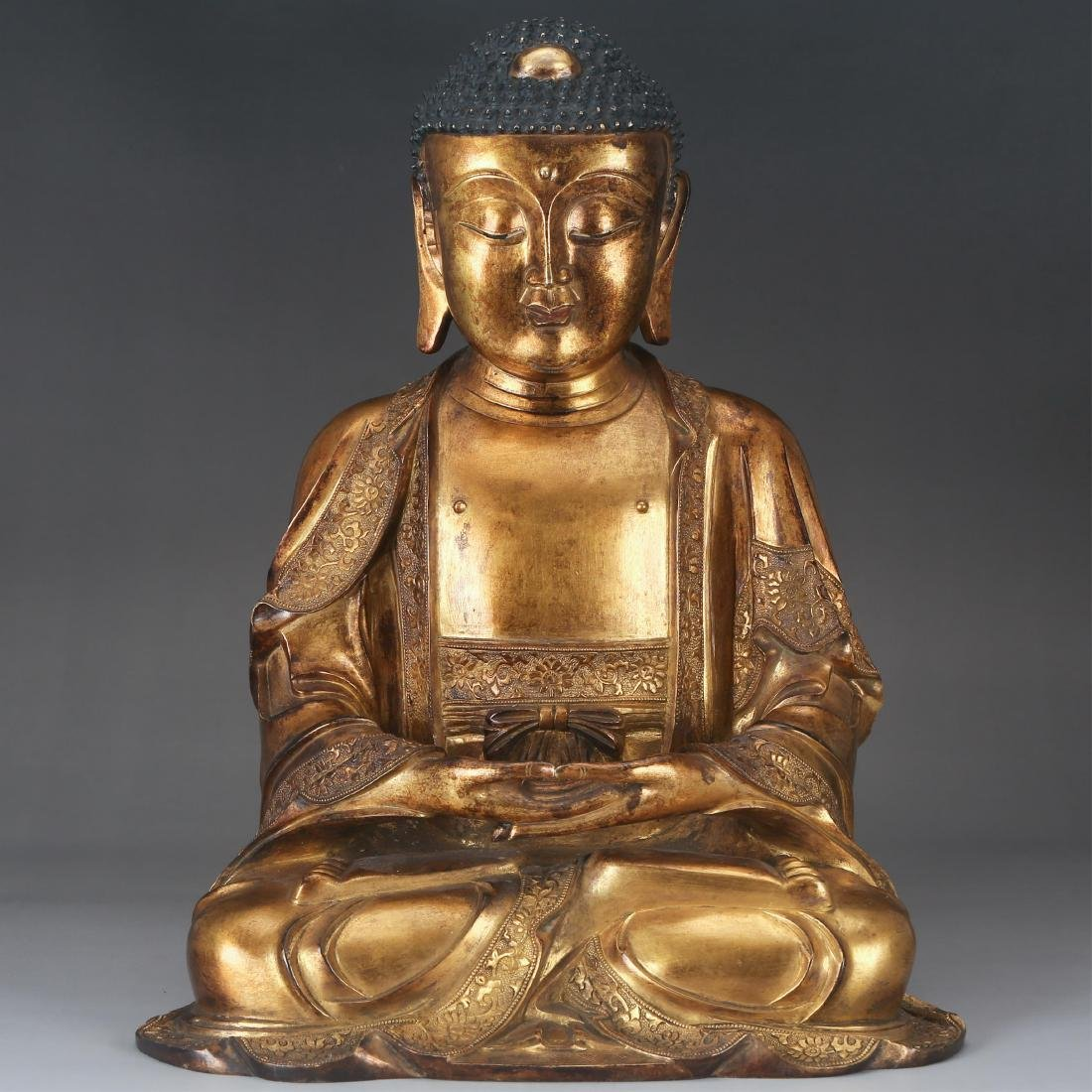 CHINESE GILT BRONZE SEATED SHAKYAMUNI, QING