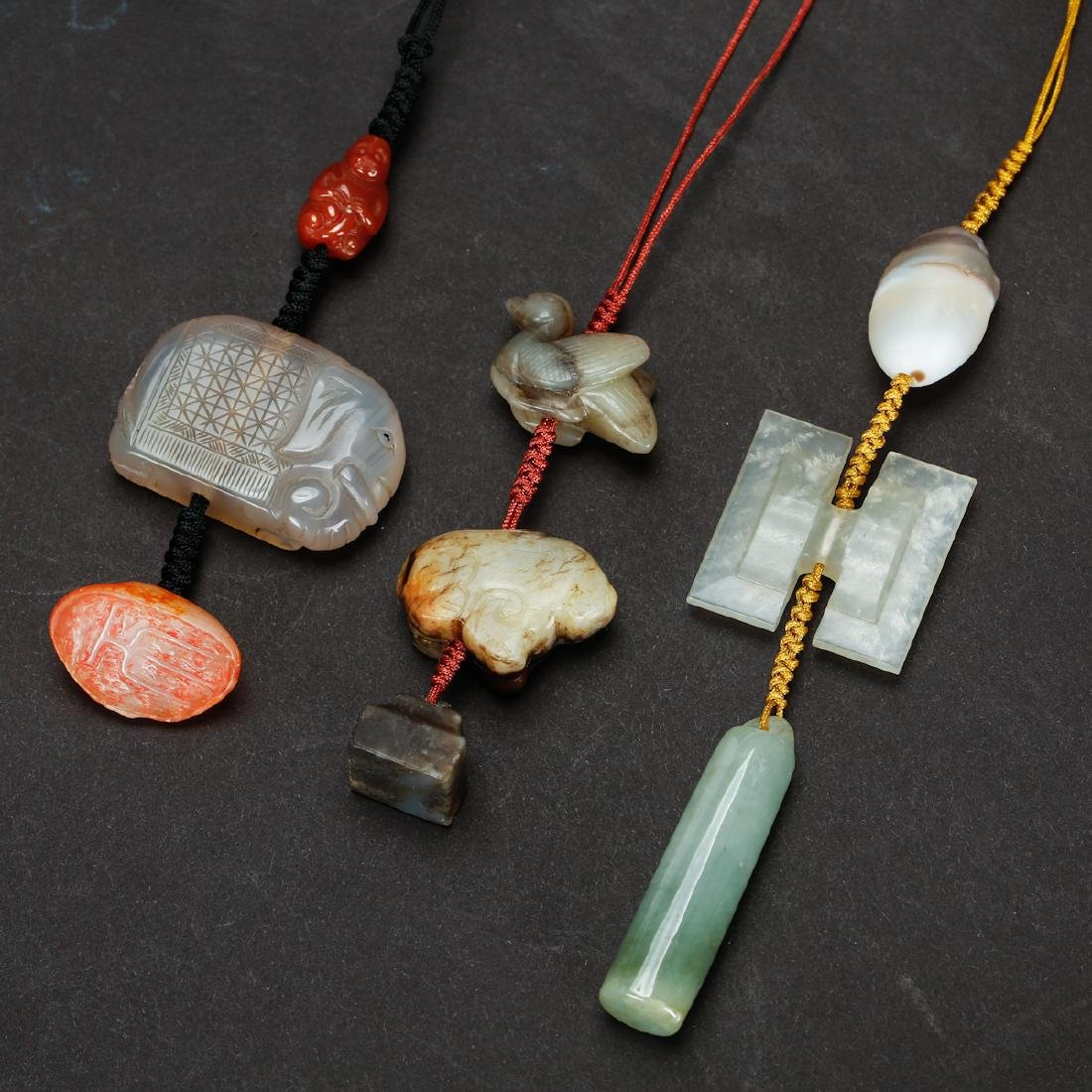 CHINESE PENDANTS OF VARIOUS MATERIALS, SET OF 3