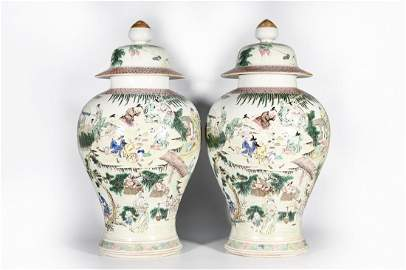 A PAIR OF FAMILLE ROSE FIGURE PORCELAIN JARS AND COVERS