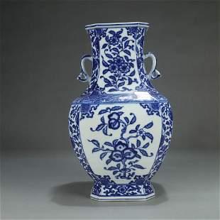 A BLUE AND WHITE FLORAL PORCELAIN OCTAGONAL VASE