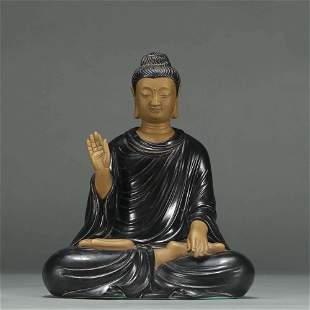 A PORCELAIN SHAKYAMUNI BUDDHA STATUE